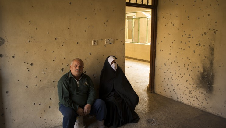 Khaled and his wife sit in one of the heavily damaged rooms inside their home the al-Tamnin neighborhood. ?We only left because of the shelling. If we had stayed, we would have been dead by now.?