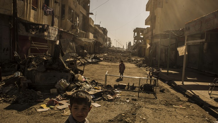 Children playing in the streets in Mosul, Iraq. The city has suffered great destruction and many of the houses and civilian infrastructure has been destroyed during the offensives.