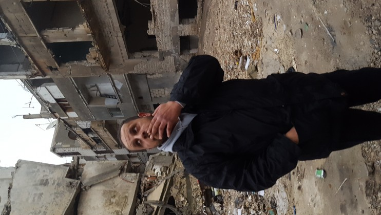Ammar visits his old neighborhood in Homs, Syria.