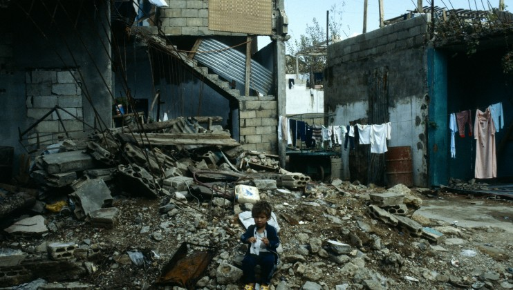 Child playing in the rubble.