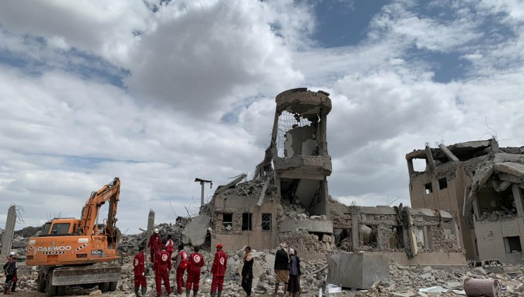 Yemeni Red Crescent teams work on retrieving bodies at the scene of an airstrike in Dhamar, Yemen on Sunday. It's thought that all of the detainees in the building were either killed or injured, according to an ICRC team on the ground.