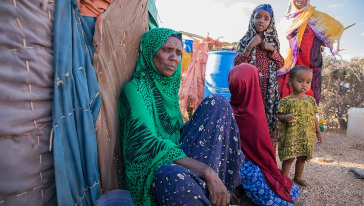 Maryan Nur Dhiriye with her grandchildren at an displacement camp in a village called Faleryare, outside Garowe. The disastrous combination of conflict and climatic shocks has left hundreds of thousands homeless. Abdikarim Mohamed/ICRC