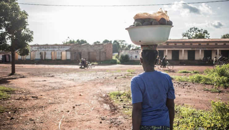 An avocado seller leaves for the market in a Muslim neighbourhood of Bangassou, south-eastern CAR, that was severely affected by the conflict.    Florent Vergnes/ICRC