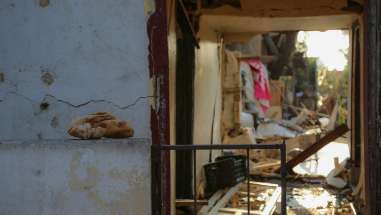 Karantina area, a destroyed home and a loaf of bread. It symbolizes two of Beirut's distressing situations - the explosion and the ongoing financial crisis.