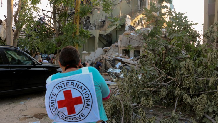 A photo of Miriam Atallah, ICRC Field Communication Officer taking photos of the damage in Karantina.