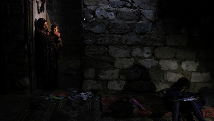 A mother is holding her child during a blackout in Gaza